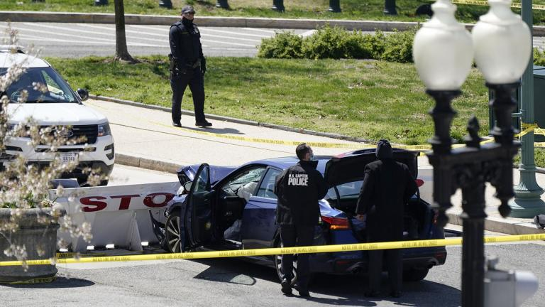 U.S. Capitol Police officers stand near a car that crashed into a barrier on Capitol Hill in Washington, Friday, April 2, 2021. (AP Photo / J. Scott Applewhite)