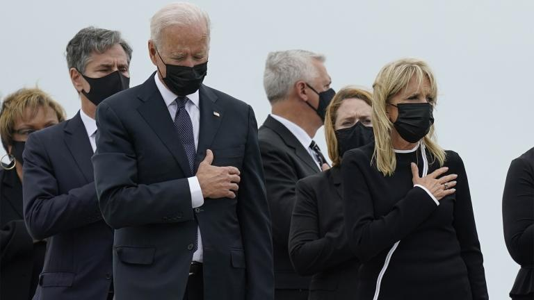 President Joe Biden and first lady Jill Biden watch as a carry team moves the transfer case containing the remains of Navy Corpsman Maxton W. Soviak, 22, of Berlin Heights, Ohio, during a casualty return Sunday, Aug. 29, 2021, at Dover Air Force Base, Del. (AP Photo / Carolyn Kaster)
