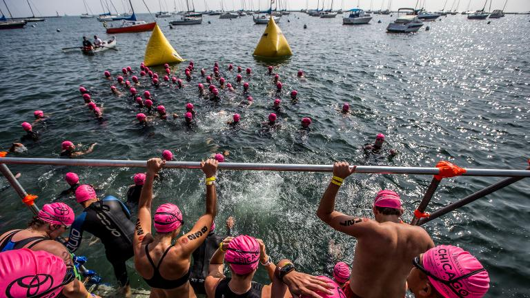 A wave of swimmers start their race in Lake Michigan at the 2015 Chicago Triathlon. (Courtesy of Transamerica Chicago Triathlon)