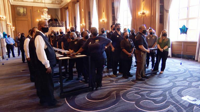 Nearly 200 previously furloughed staff members returned to the Chicago Hilton and Towers Thursday, June 10, 2021, to prepare for the city and state's full reopening Friday. (WTTW News)