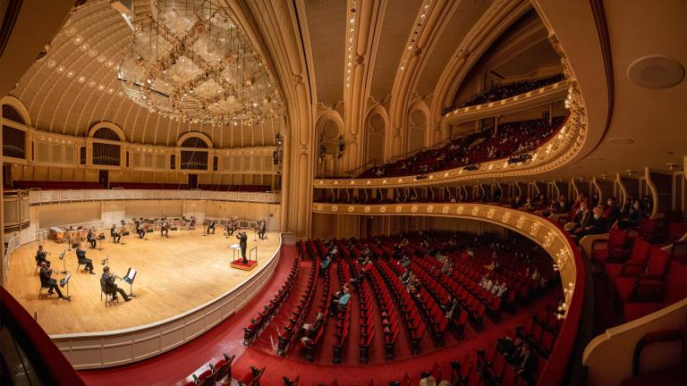 A socially distanced, reduced-capacity audience listens to the sounds of the CSO brass at the concert that signaled the return of Chicago Symphony Orchestra concerts, May 27, 2021. (Credit Anne Ryan)