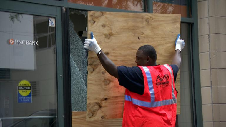 A bank is boarded up in Chicago following civil unrest and property damage in the summer of 2020. (WTTW News)