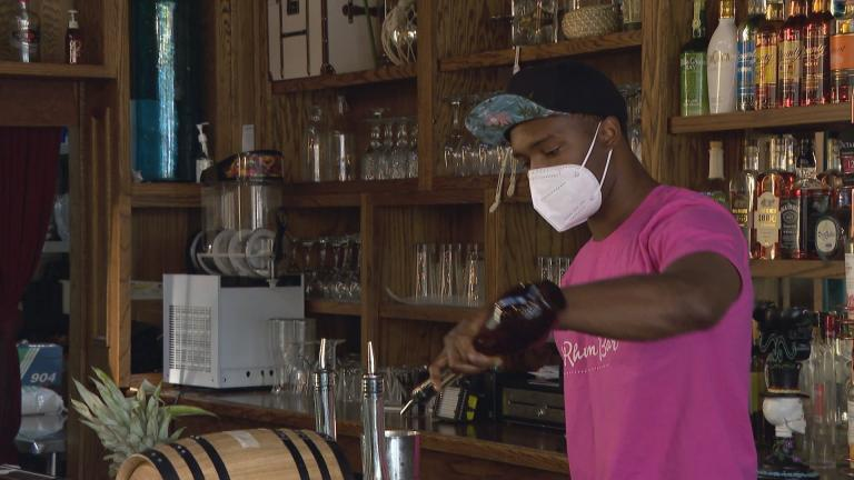 A bartender mixes a drink at the Chicago restaurant 14 Parish. (WTTW News)