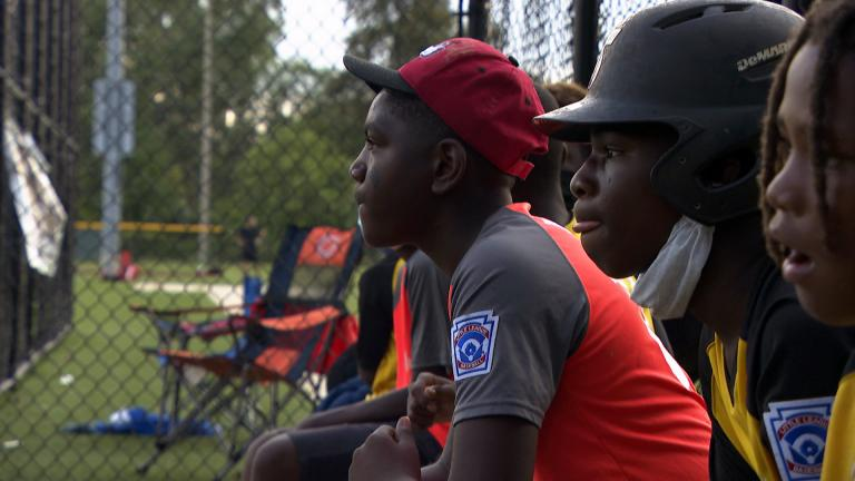 Participants in Chicago Westside Sports play baseball at Columbus Park. (WTTW News)