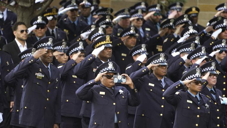 Chicago police officers salute as the body of slain Chicago police Officer Ella French is carried into the St. Rita of Cascia Shrine Chapel for a funeral service Thursday, Aug. 19, 2021, in Chicago. (AP Photo / Charles Rex Arbogast)