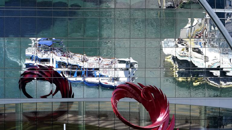Chicago River tour boats are reflected by a building window in Chicago, Wednesday, Sept. 1, 2021. (AP Photo / Nam Y. Huh)
