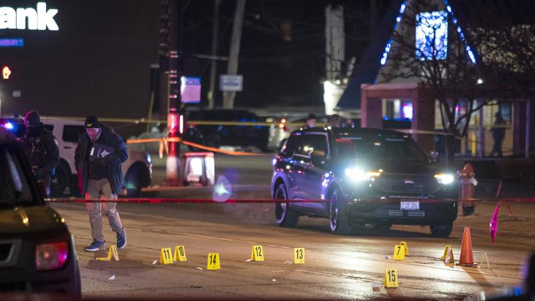 Chicago and Evanston police investigate a crime scene after a gunman went on a shooting spree before being killed by police during a shootout in Evanston on Saturday night, Jan. 9, 2021. (Ashlee Rezin Garcia / Chicago Sun-Times via AP)