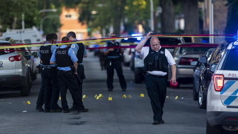 Chicago police officers investigate the scene of a deadly shooting where a 7-year-old girl and a man were fatally shot in Chicago on Sunday, July 5, 2020. (Tyler LaRiviere / Chicago Sun-Times via AP)