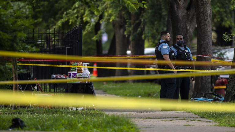 Chicago police investigate the scene where multiple people were shot in the 8200 block of South Drexel, in the Chatham neighborhood of Chicago, Friday, July 17, 2020. (Tyler LaRiviere / Chicago Sun-Times via AP)