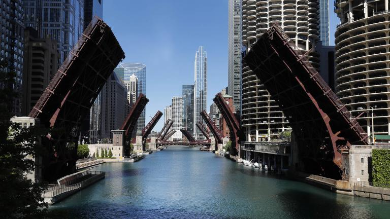In this May 31, 2020 file photo, several street bridges over the Chicago River remain closed in Chicago, after a night of unrest and protests over the death of George Floyd, a Black man who was in police custody in Minneapolis. (AP Photo / Charles Rex Arbogast)