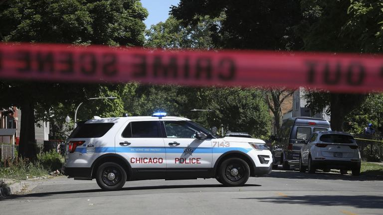 Police tape marks off a Chicago street as officers investigate the scene of a fatal shooting in the city's South Side on Tuesday, June 15, 2021. An argument in a house erupted into gunfire early Tuesday, police said. (AP Photo / Teresa Crawford)