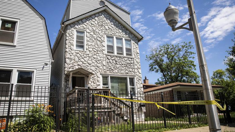 Crime scene tape hangs outside a house where multiple people were shot, some fatally, inside the Englewood building, Tuesday, June 15, 2021. (Ashlee Rezin Garcia / Chicago Sun-Times via AP)
