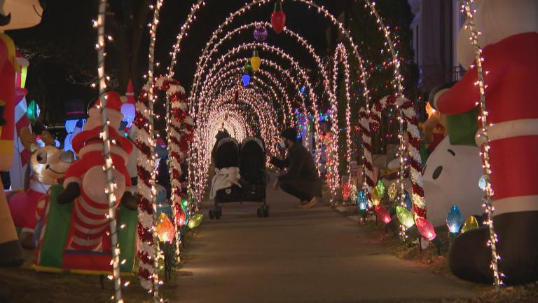 A holiday lights display on Francisco Avenue in Chicago. Public health officials urged residents across the state to avoid travel and large gatherings this holiday season to curb the spread of COVID-19. (WTTW News)
