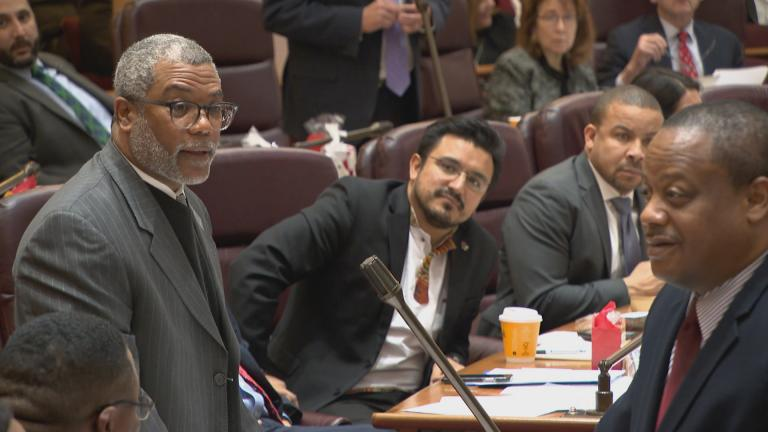 "Ald. Walter Burnett, left, clarifies his use of the word ""bump"" during a tension-filled City Council meeting on Wednesday, Dec. 18, 2019. (WTTW News)"