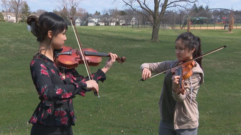 Sisters Claire, left, and Esme Arias-Kim (WTTW News)