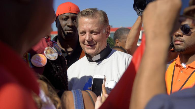In this Saturday, July 7, 2018 file photo, the Rev. Michael Pfleger speaks to protesters before marching on the Dan Ryan Expressway in Chicago. (AP Photo / Annie Rice, File)