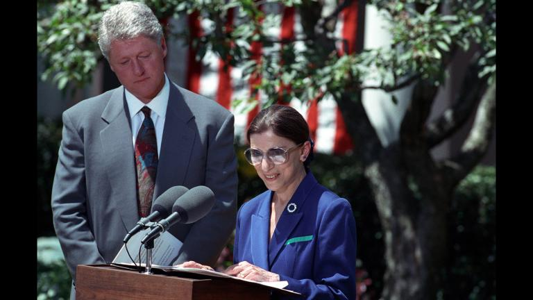 President Bill Clinton looks on as Ruth Bader Ginsburg speaks after the announcement of her nomination to the Supreme Court in June 1993. (Sharon Farmer / National Archives and Records Administration)