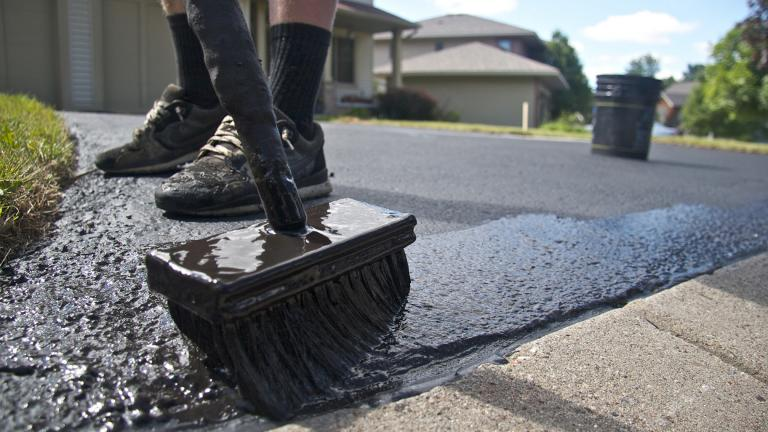 The Minnesota Legislature banned the sale and use of coal tar-based sealants on January 1, 2014. These products were commonly applied to asphalt driveways and parking lots. (MPCA Photos / Flickr)