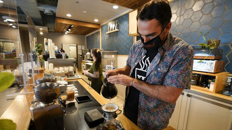 Chris Vigilante makes a dripped coffee for a customer at one of his coffee shops, Wednesday, Sept. 1, 2021, in College Park, Md. (AP Photo / Julio Cortez)