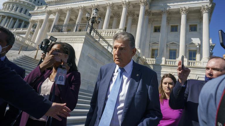 Sen. Joe Manchin, D-W.Va., a centrist Democrat vital to the fate of President Joe Biden's $3.5 trillion domestic agenda, is surrounded by reporters outside the Capitol in Washington, Wednesday, Sept. 29, 2021. (AP Photo / J. Scott Applewhite)