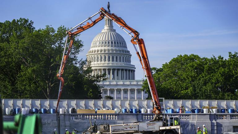 A concrete pump frames the Capitol Dome during renovations and repairs to Lower Senate Park on Capitol Hill in Washington, Tuesday, May 18, 2021. (AP Photo / J. Scott Applewhite)