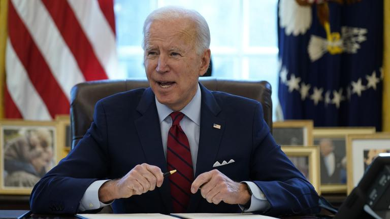 President Joe Biden signs a series of executive orders on health care, in the Oval Office of the White House, Thursday, Jan. 28, 2021, in Washington. (AP Photo / Evan Vucci)