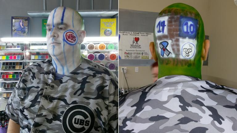 Russell Duffer shows off a Cubs-themed pinstripes-and-ivy paint job courtesy of makeup artist Colleen Jones. (Erica Gunderson / Chicago Tonight)