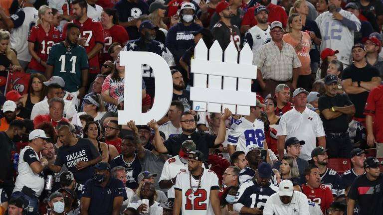 A Tampa Bay Buccaneers fan holds a sign during the first half of an NFL football game against the Dallas Cowboys Thursday, Sept. 9, 2021, in Tampa, Fla. (AP Photo / Mark LoMoglio)
