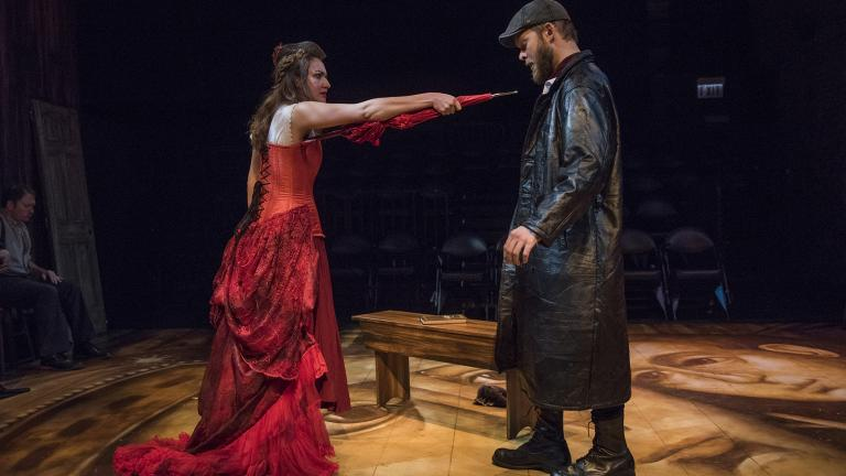 "Ilse Zacharias (left) and Drew Schad in Shattered Globe Theatre's new adaptation of ""Crime and Punishment."" (Photo by Michael Brosilow)"