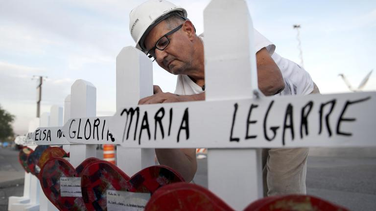 In this Aug. 5, 2019, file photo Greg Zanis of Aurora prepares crosses to place at a makeshift memorial for victims of a mass shooting at a shopping complex in El Paso, Texas. (AP Photo / John Locher, File)