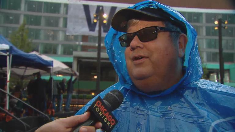Cubs fan Tim Leahy reacts to Tuesday's postponement.