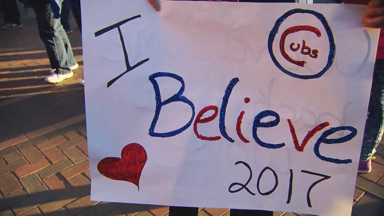 A Cubs fan shows off a sign before Game 3 at Wrigley Field. (Chicago Tonight)