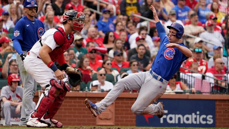 Chicago Cubs' Frank Schwindel, right, scores past St. Louis Cardinals catcher Andrew Knizner during the fifth inning of a baseball game Sunday, Oct. 3, 2021, in St. Louis. (AP Photo / Jeff Roberson)
