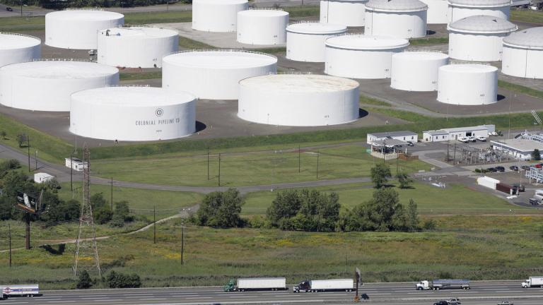 In this Sept. 8, 2008 file photo traffic on I-95 passes oil storage tanks owned by the Colonial Pipeline Company in Linden, N.J. (AP Photo / Mark Lennihan, File)