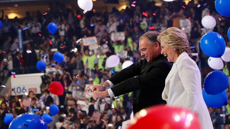 Hillary Clinton and her running mate Tim Kaine greet the crowd after her speech. (Evan Garcia / Chicago Tonight)