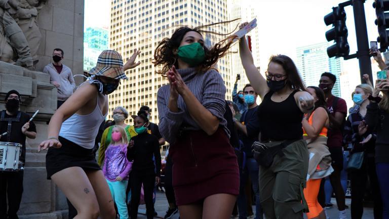 Women dance outside Trump Tower on Saturday, Nov. 7, 2020. (Grace Del Vecchio / WTTW News)