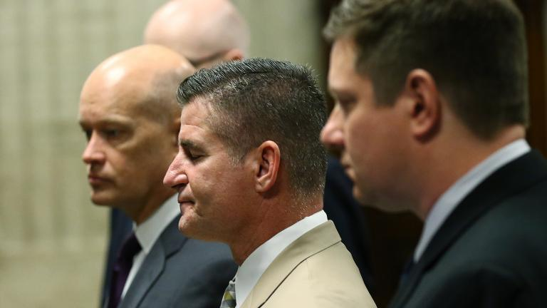 Defense attorney Dan Herbert, center, reacts to Cook County Judge Vincent Gaughan's remarks during the murder trial of Chicago police Officer Jason Van Dyke, right, on Oct. 3, 2018. (John J. Kim / Chicago Tribune / Pool)
