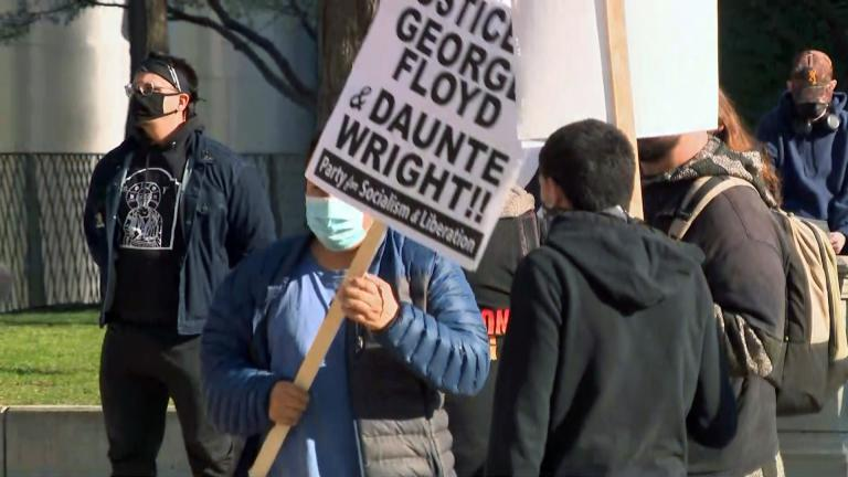 A handful of officers looked on as a group of approximately 100 gathered near the Cloud Gate sculpture downtown to protest police brutality. April 13, 2021 (WTTW News)