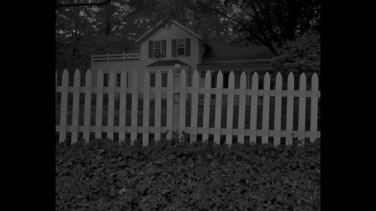"Dawoud Bey. ""Untitled #1 (Picket Fence and Farmhouse),"" from the series ""Night Coming Tenderly, Black,"" 2017. Rennie Collection, Vancouver. © Dawoud Bey."