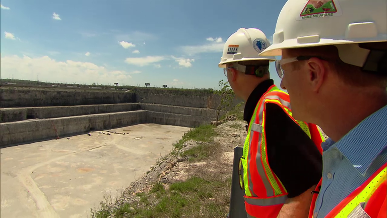 "Jay Shefsky of ""Chicago Tonight"" surveys the Thornton Quarry in May 2015 with engineer Kevin Fitzpatrick of the Metropolitan Water Reclamation District of Greater Chicago."