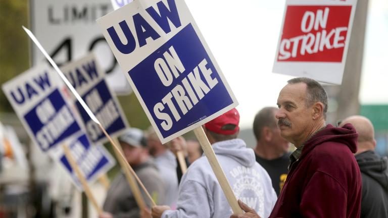 John Deere Dubuque Works union employee Steve Thor pickets outside UAW Local 94 in Dubuque, Iowa, on Thursday, Oct. 14, 2021. (Jessica Reilly / Telegraph Herald via AP)