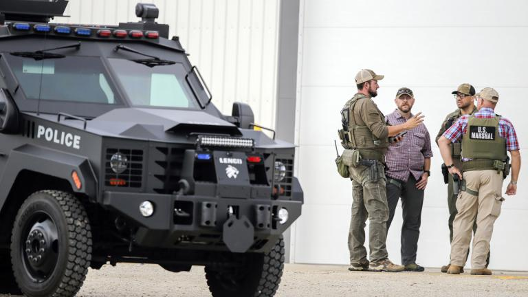A tactical vehicle from the Cedar Rapids Police Department is seen as law enforcement stage as they search for a robbery and shooting suspect in Coggon, Iowa, on Monday, June 21, 2021. (Jim Slosiarek / The Gazette via AP)