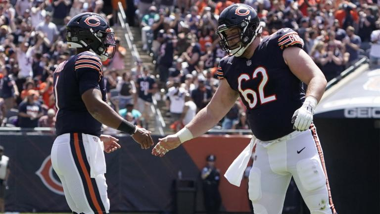 Chicago Bears quarterback Justin Fields, left, is congratulated by Adam Redmond (62) after throwing a touchdown pass against the Miami Dolphins during the second half of an NFL preseason football game in Chicago, Saturday, Aug. 14, 2021. (AP Photo  /David Banks)