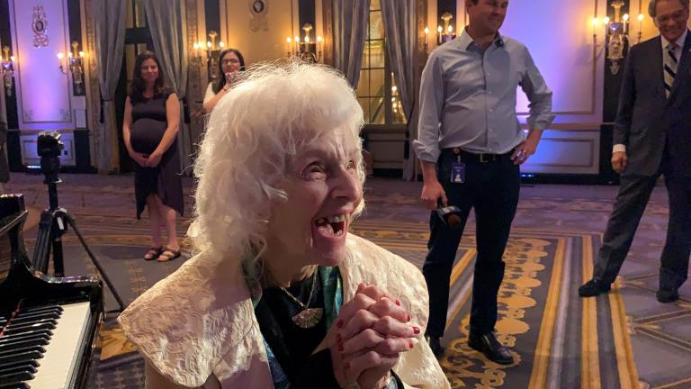 Pianist Dorothy Olson Pauletti reacts to receiving a lifetime achievement award from the Chicago Federation of Musicians.