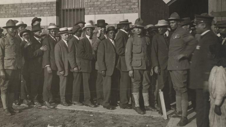 Men line up to enlist in World War I. (Courtesy of Christopher Reed)