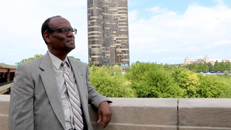 "Dr. Serge Pierre-Louis stands in front of the DuSable Park site. ""The leaders of Chicago can use the story of DuSable to solve the problems we're facing now,"" he said. (Evan Garcia / Chicago Tonight)"
