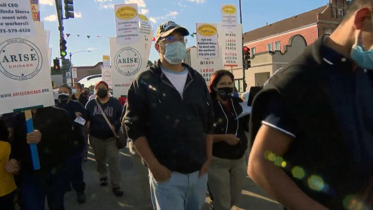 A group of workers with tortilla maker El Milagro march across 26th Street to protest working conditions on Thursday, Sept. 23, 2021. (WTTW News)