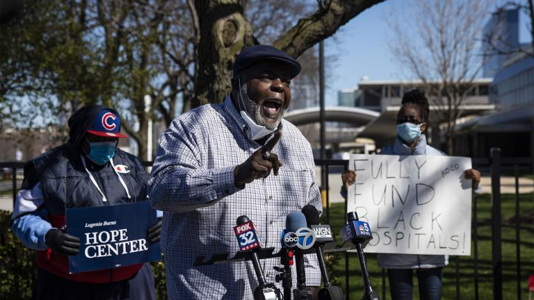 In this April 20, 2020 file photo, Jitu Brown, national director for the Journey for Justice Alliance, speaks to reporters outside Mercy Hospital & Medical Center in Chicago. Brown said school closures and other city policies have disproportionately affected people of color and contributed to Chicago's loss of Black residents. (Ashlee Rezin Garcia / Chicago Sun-Times via AP)