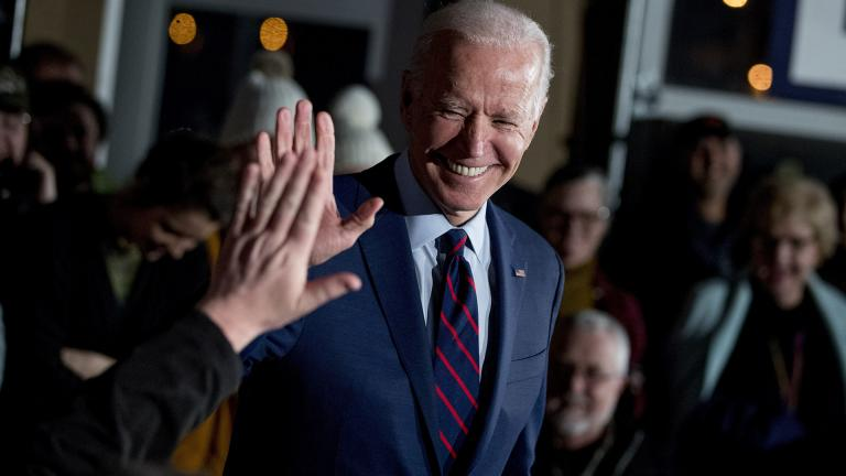 In this Jan. 5, 2020, file photo Democratic presidential candidate, former Vice President Joe Biden high-fives a member of the audience during a campaign rally at Modern Woodmen Park in Davenport, Iowa. (AP Photo / Andrew Harnik, File)