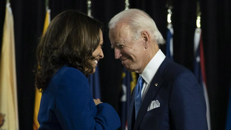 Democratic presidential candidate former Vice President Joe Biden and his running mate Sen. Kamala Harris, D-Calif., pass each other as Harris moves to the podium to speak during a campaign event at Alexis Dupont High School in Wilmington, Del., Wednesday, Aug. 12, 2020. (AP Photo / Carolyn Kaster)
